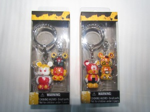 Keychains with different Vinylmation designs; two of the possibilities are shown.